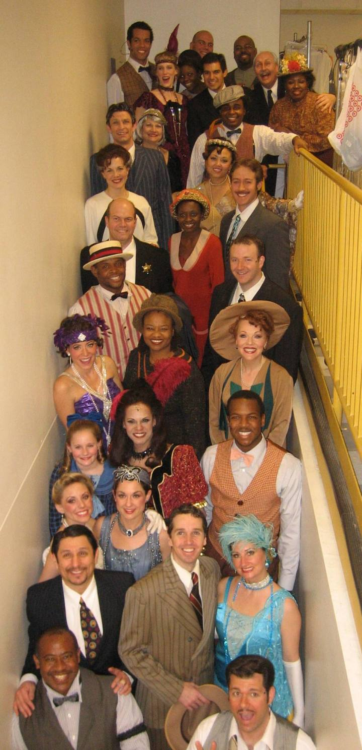The cast of SHOW BOAT, featuring  The cast of SHOW BOAT, featuring James Monroe Inglehart, top third from right, and Dennis Yslas, second from bottom, left.