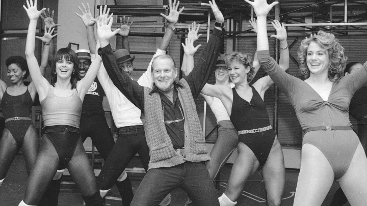 Bob Fosse (center) leads the cast during a rehearsal of his musical Big Deal on Broadway in 1986.